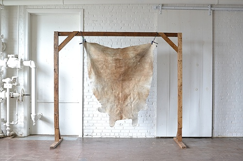 Tan Cowhide Rug available for rent by Paisley & Jade