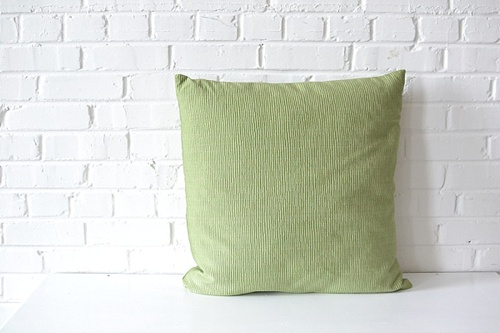Oversized Green Square Pillow available for rent by Paisley & Jade