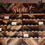 Donut wall created with custom built chevron wooden backdrops available for rent by Paisley and Jade
