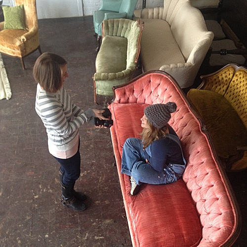 Co-captain of Paisley & Jade, Perkins, posed on an upholstered couch while Stephanie Yonce Photography takes a quick photo!
